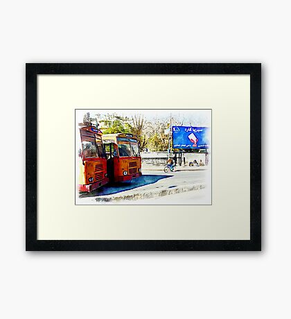 Buses and child riding a bicycle in Aleppo Framed Print