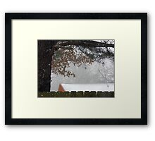 Snowing On The Rooftops Framed Print