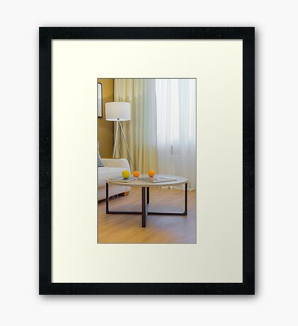 Journal table in the contemporary interior Framed Print