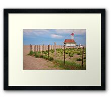 Lifeguard Hut Seen through Fence Framed Print