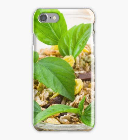 Dry mix of muesli and cereal in a bowl of glass iPhone Case/Skin