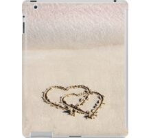 Two hearts drawn in the sand on a beautiful beach iPad Case/Skin