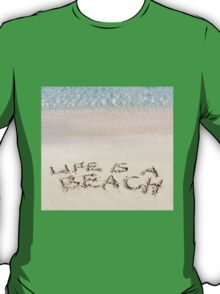 Life is a beach message written on white sand, with tropical sea waves in background T-Shirt