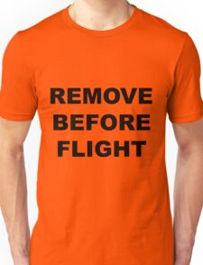 Remove Before Flight warning in black letters Unisex T-Shirt