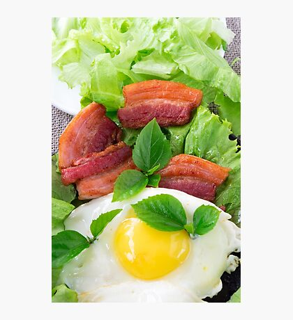 Plate with egg yolk, fried bacon and herbs Photographic Print