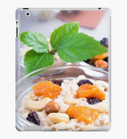One portion of oatmeal with fruit and berries in a glass iPad Case/Skin