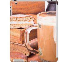 Glass mug with hot chocolate on a table iPad Case/Skin
