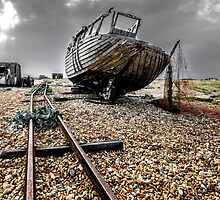 Atmospheric photo of abandoned fishing boat on Dungeness beach, Kent by Luke Farmer