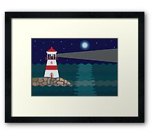 Lighthouse on the stony shore at night Framed Print