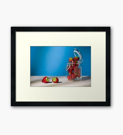 Strawberries on a table and a glass jar full of strawberries Framed Print
