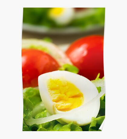 Boiled egg on a plate with lettuce, onions and cherry Poster