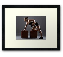 Fitness girl doing dumbbell rows Framed Print