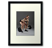 Fitness girl with barbell doing deadlift Framed Print