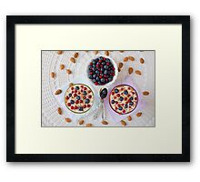 Two yogurt dessert with berries and almonds seen from above Framed Print
