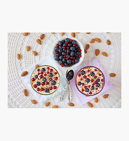 Two yogurt dessert with berries and almonds seen from above Photographic Print