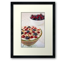 Closeup of a yogurt dessert with berries and almonds Framed Print