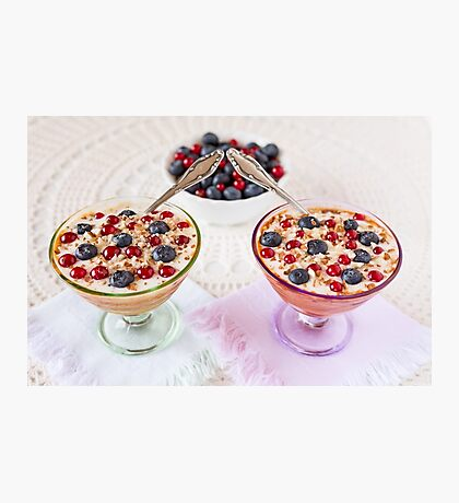 Two yogurt dessert with berries, almonds and spoons Photographic Print