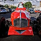 Red old Sports Car by Wolf Sverak