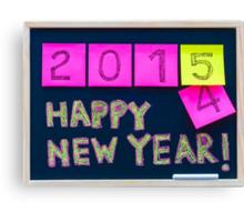 Happy New Year 2015 message hand written on blackboard Canvas Print