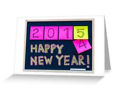 Happy New Year 2015 message hand written on blackboard Greeting Card