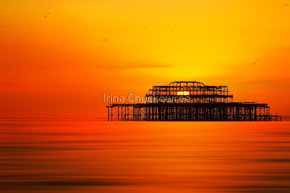 Sunset over West Pier, Brighton. by Irina Chuckowree