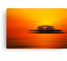 Sunset over West Pier, Brighton. Canvas Print