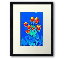 Red tulips on blue Framed Print