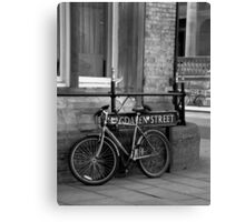 A bike on Magdalen Street, Oxford, England Canvas Print