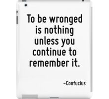 To be wronged is nothing unless you continue to remember it. iPad Case/Skin