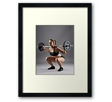 Athletic woman doing barbell squats Framed Print