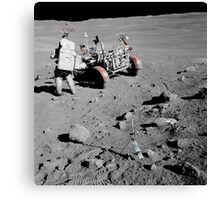 Apollo 16 astronaut stands near the Lunar Roving Vehicle. Canvas Print