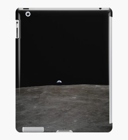 Earth rises over the lunar horizon. iPad Case/Skin