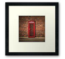 British Phone Box Against Red Brick Wall Framed Print