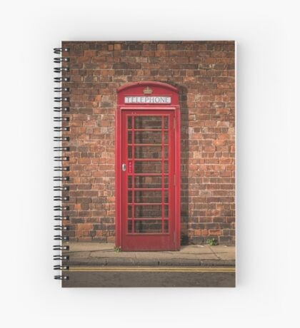 British Phone Box Against Red Brick Wall Spiral Notebook