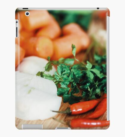 Onion, Carrots, Bell Peppers, Garlic And Parsley Raw Vegetables Ingredients On Wood iPad Case/Skin
