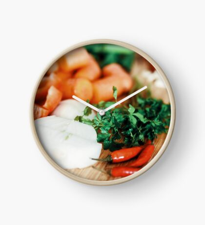 Onion, Carrots, Bell Peppers, Garlic And Parsley Raw Vegetables Ingredients On Wood Clock