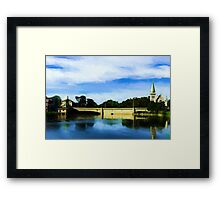 Small town with church on river bank Framed Print