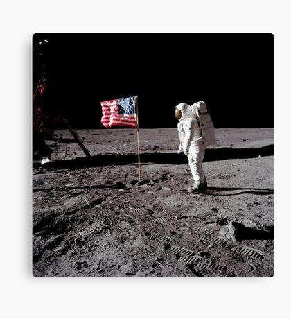 Astronaut salutes the American flag during an Apollo 11 moonwalk. Canvas Print