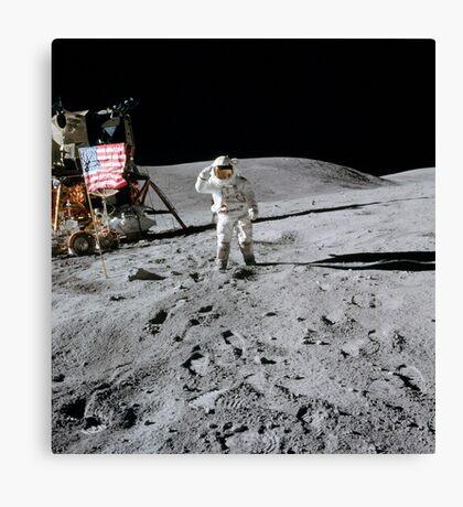 Astronaut salutes the American flag during an Apollo 16 moonwalk. Canvas Print