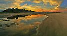 Low Tide at Bamburgh Castle. by David Alexander Elder