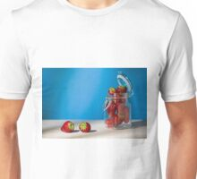 Strawberries on a table and a glass jar full of strawberries Unisex T-Shirt