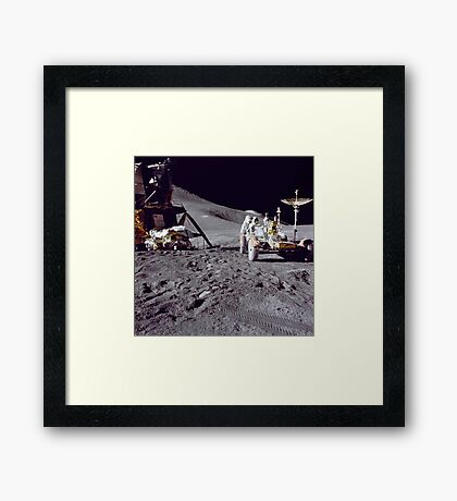 Apollo 15 astronaut loads the lunar rover with tools and equipment. Framed Print