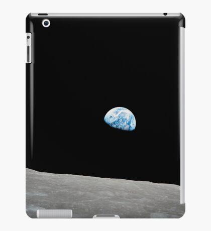 Earth rising above the lunar horizon. iPad Case/Skin