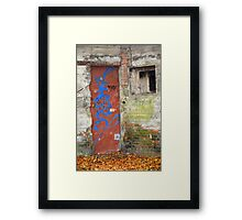 Old rusty WWII bunker door with graffiti Framed Print