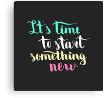 It is time to start something new. Colorful text on dark background. Canvas Print