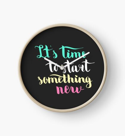 It is time to start something new. Colorful text on dark background. Clock