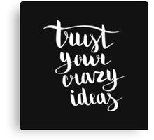 Trust your crazy ideas. White text on dark background. Canvas Print
