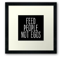 Feed people not egos Framed Print
