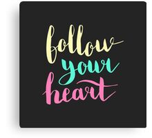 Follow your heart. Colorful text on dark background. Canvas Print