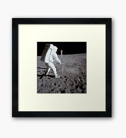 Astronaut during Apollo 11 extravehicular activity on the moon. Framed Print